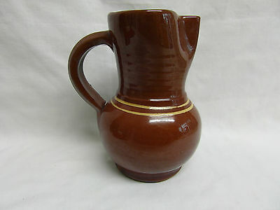Brown pottery earthenware jug fluted spout