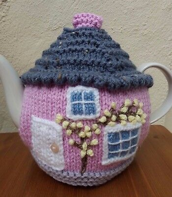 Chunky knit pink cottage tea cosy