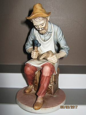 Ceramic figurine old man sitting cobbling size 185 mm in height ex/cond