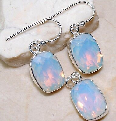 18CT Fire Opalite Sterling Silver Earrings And Pendant Set.