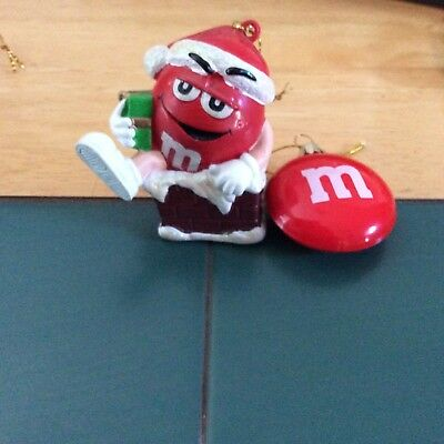 m&m 2 ornaments red wearing santa hat sitting on chimney & red funny face