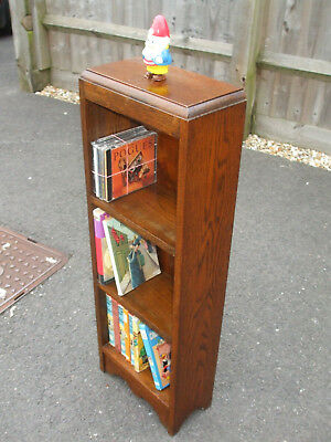 Small antique oak slimline bookcase, very solid and weighty, with a good colour