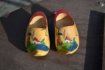 Vintage carved wooden ornamental clogs