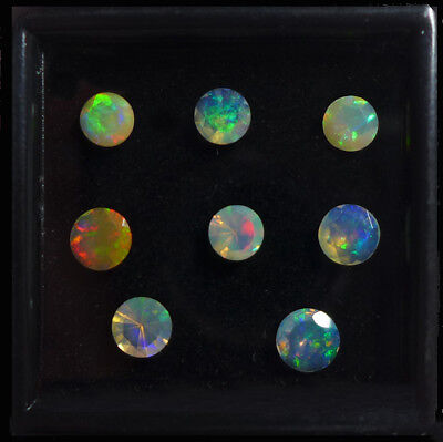 2.26 ct.!  8 Stück facettierte runde 5 - 5.7 mm  Multi-Color Opale