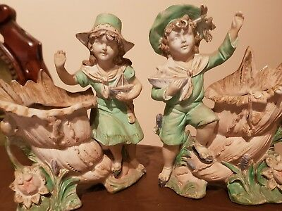 antique bisque girl and boy spill vases