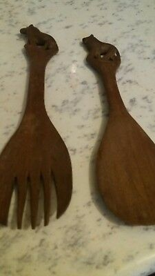 wooden spoon and fork with lion on top
