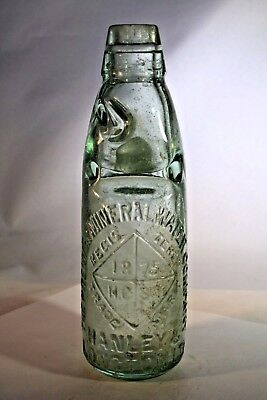Vintage embossed 1875 mineral water bottle with marble stopper inside, England