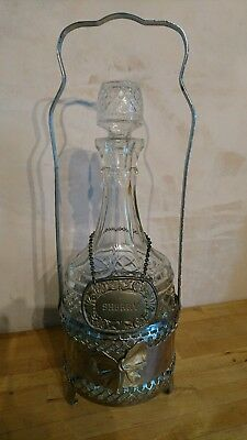A Stunning Antique Glass Decanter In Ornate Silver Plated Holder