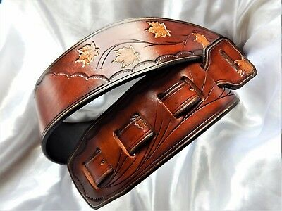 Lovely hand-made hand carved leather guitar strap. Great price!!