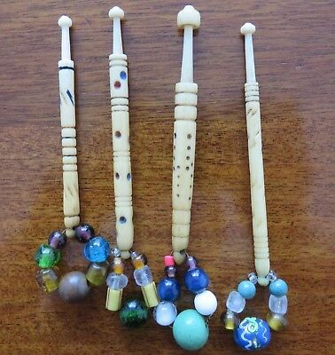 Four plus one antique lace bobbins with antique beads