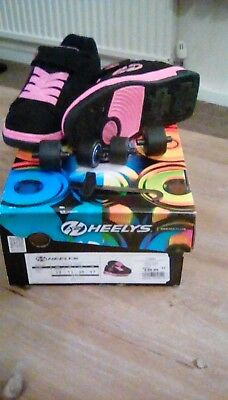 heelys size 11girls dual up in pink.