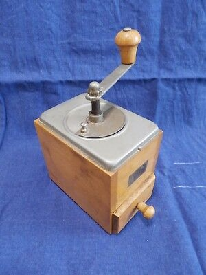 Vintage Wooden John Dunhill Tobacco Grinder with hand crank and drawer.