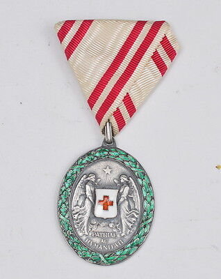 Austria, Silver Red Cross Medal with war decoration, wreath