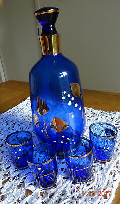 Vintage cobalt blue decanter and 4 small glasses