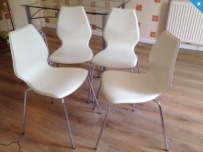 4 Dining Stacking Chairs very good condition Quick Sales