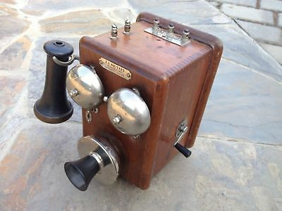 Antique walnut and nickel wall phone made in Lewiston Maine.