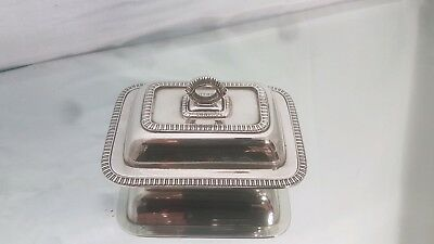 A beautiful vintage silver plated butter dish with decorated patterns.