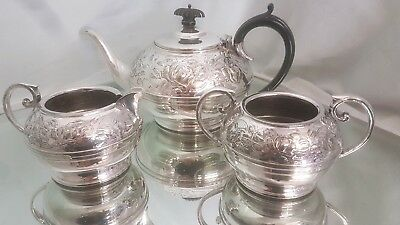 A beautiful vintage silver plated tea set with embossed floral patterns