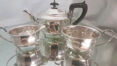 An elegant vintage silver plated tea set on pawed legs.made in sheffield.