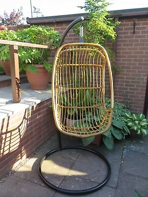 Hanging Wicker Chair - Stand Black- Seats 1- in used condition