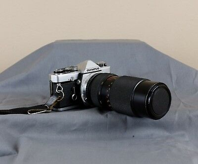 Olympus OM-1 w/Formula 5 80-205mm lens. As is. Fixer upper or parts