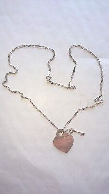 Silver Necklace with tiffany & co imprinted heart and key