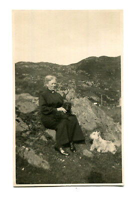 1925 postcard Katie Macrae with two dogs taken at Kyle of Lochalsh