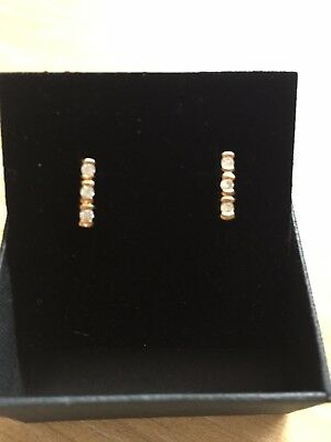 Gold 9ct earrings with three small diamonds