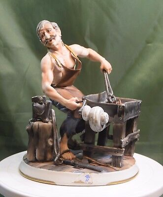 A Large Capodimonte Blacksmith Signed M.lozy.