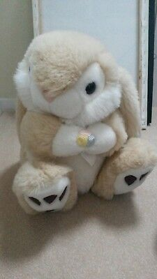 cuddly rabbit large holding  flower, good condition
