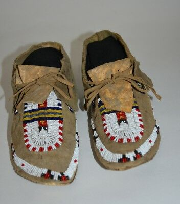 A pair of Hide and Beaded Southern Plains Moccasins,late 19th early 20th century