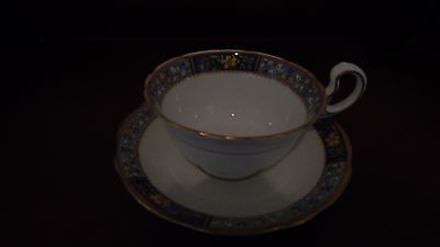 Aynsley tea cup and saucer # A4670 White w/Gold and Blue trim and floral design