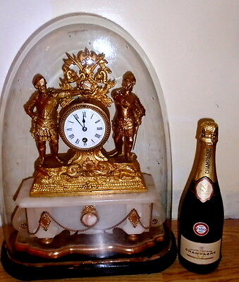 Antique large French ormulo mantel clock with dome in lovely order.