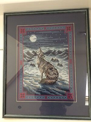 completed cross stitch framed