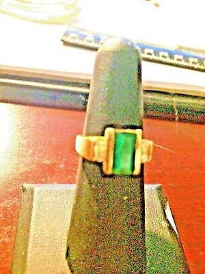Art Deco 14 kt yellow gold emerald and two diamomds on each side very clear ....