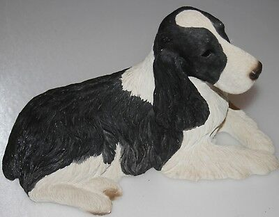 Sandi Cast  Dog Statue Figure. 10 inches wide  by 8 inches high
