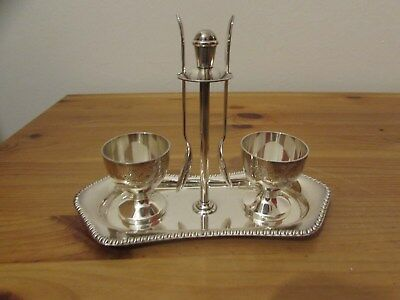 A good quality pair of electroplated eggcups and spoons - on associated tray