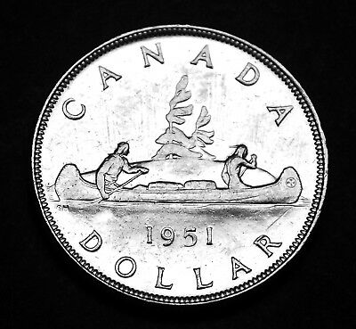 1951 silver Canadian $1 coin that shows all the details.  Great coin.