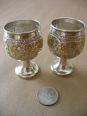 A pair of unique antique/vintage embossed, gold washed sterling silver cordials