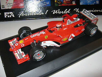1:18 FERRARI F2004 M. SCHUMACHER 2004 rebuilt full tabacco in showcase TOP