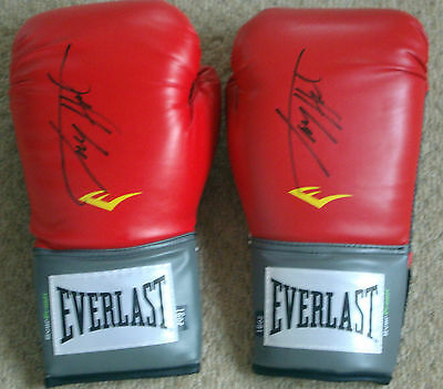 """Larry Holmes Pair of Red Everlast Boxing Gloves """"Signature on each Glove"""""""