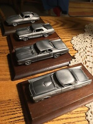 Avon set of 4 Pewter Classic Cars with woodbase