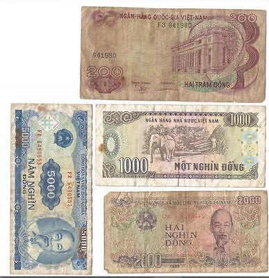 4 old paper notes from Vietnam dirty stained & worn