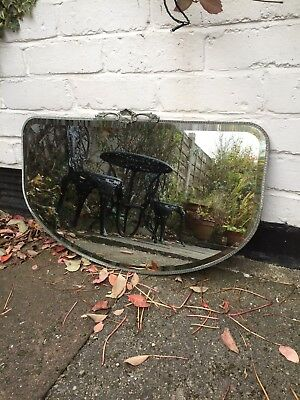 1920's DECO VINTAGE OVAL MIRROR WITH  SILVER DETAILING RIM AND ORNATE CREST