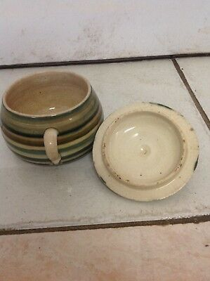very old porcelain pot with lid