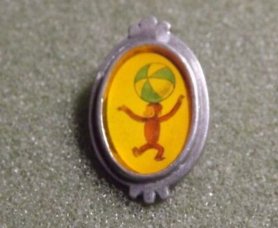 Curious George Lapel Pin Back Brooch Monkey Balancing Ball On Head Inside Frame