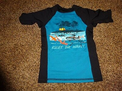 Boys Size 4 the childrens place swim shirt Gently used