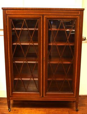 ATTRIBUTED IRVING & CASSON/A.H. DAVENPORT MAHOGANY BOOKCASE: Lot 172