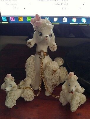 vintage 1950s white porcelain poodle mother and two pups with pink flower