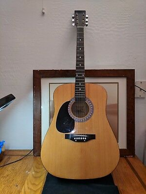 Acoustic Guitar left handed Burswood signed but can't make it out. Made in China